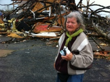 Mary Hazelbaker in front of what's left of her Joplin home