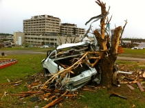St. Johns Regional Medical Center in Joplin with wreckage of vehicle in foreground